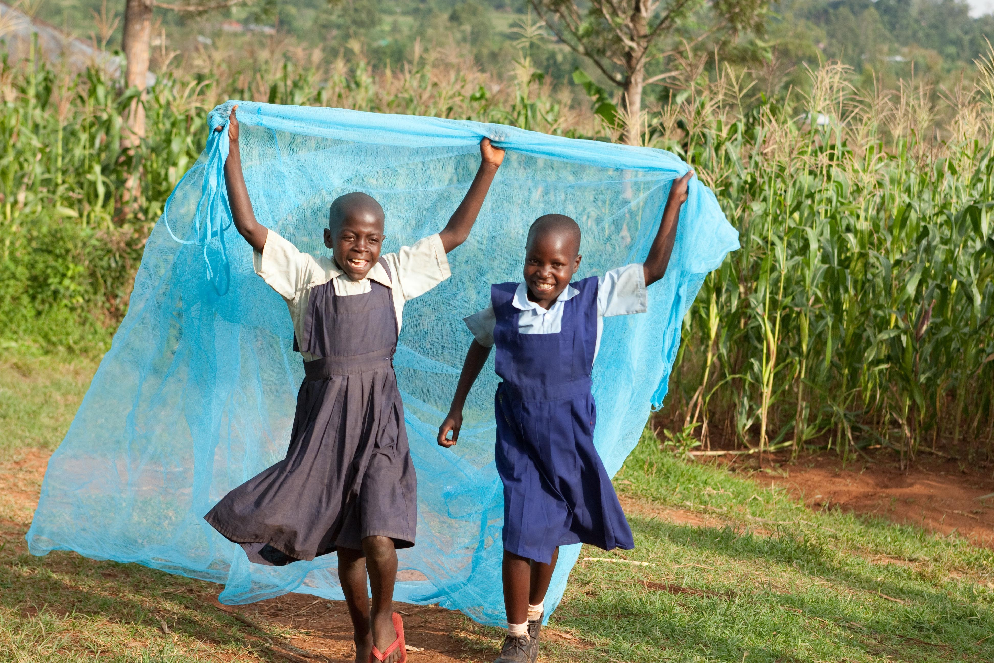 Clementine and Linet Project, Kisumu, Kenya. Clementine Akinyi left and Linet Atieno on right near homes in Ulumbi